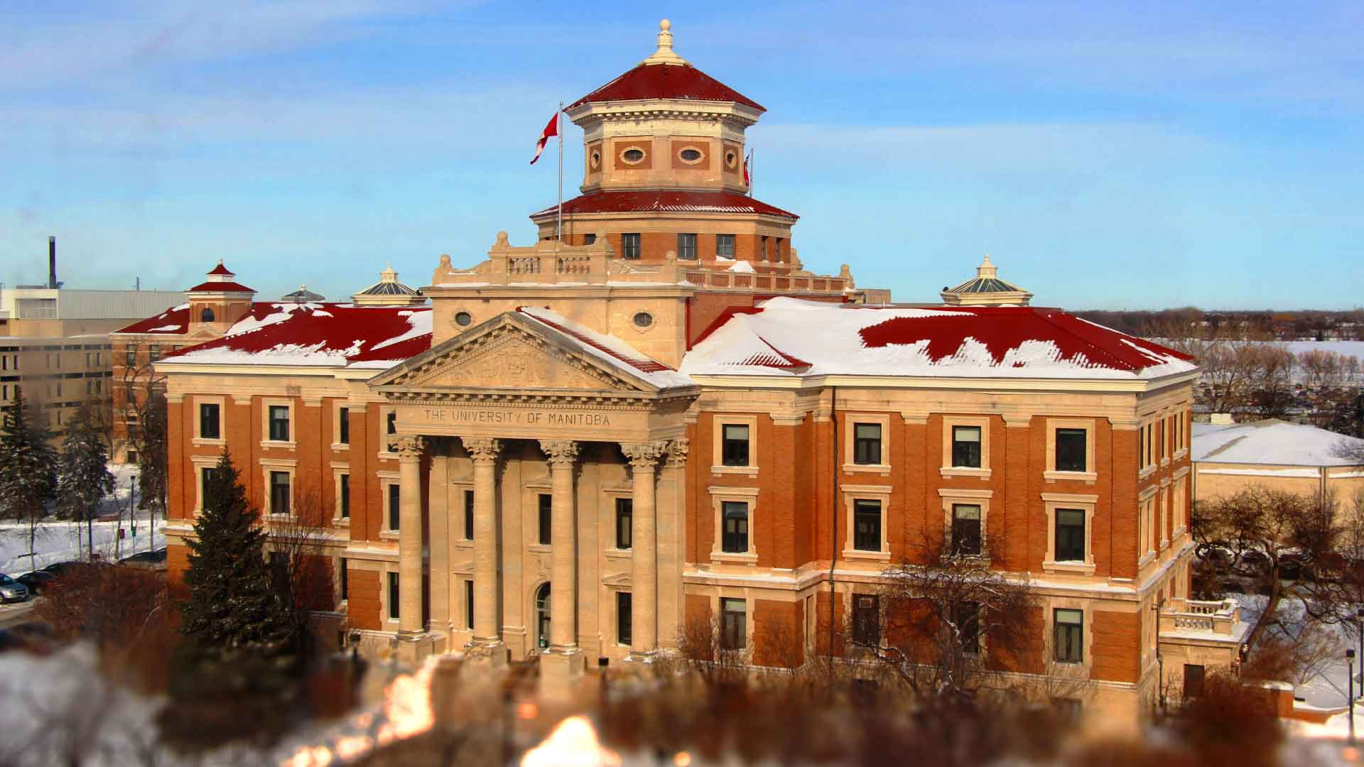 Blue skies above the University of Manitoba Administration Building with snow