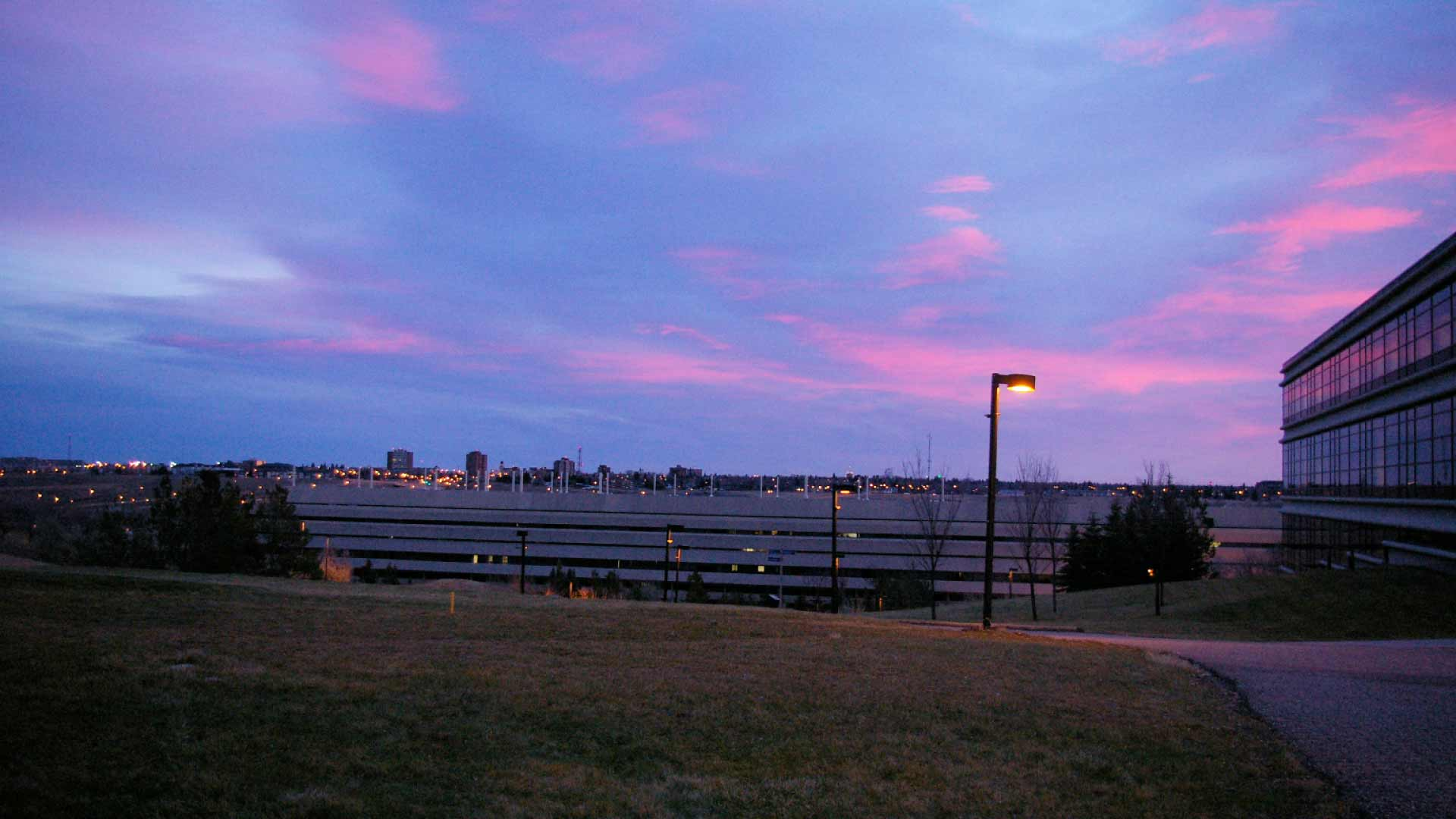Pink and blue skies over the University of Lethbridge at sunset