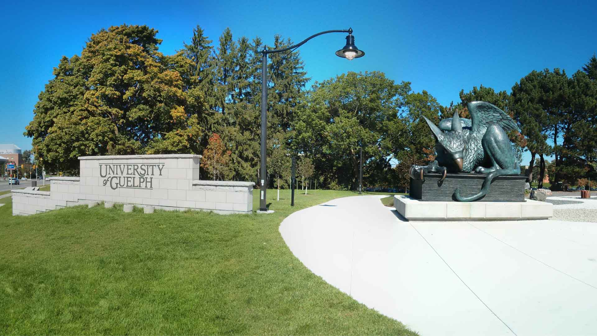 Gryphon statue and sign on University of Guelph campus